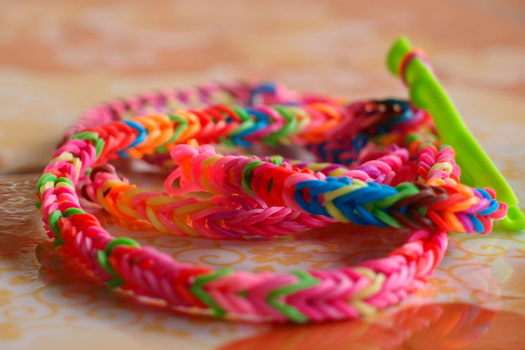 Close-up of colorful rubber band bracelet on table