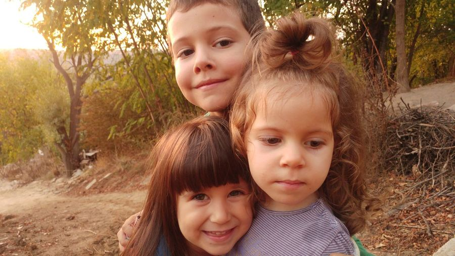 Portrait of children on dirt road