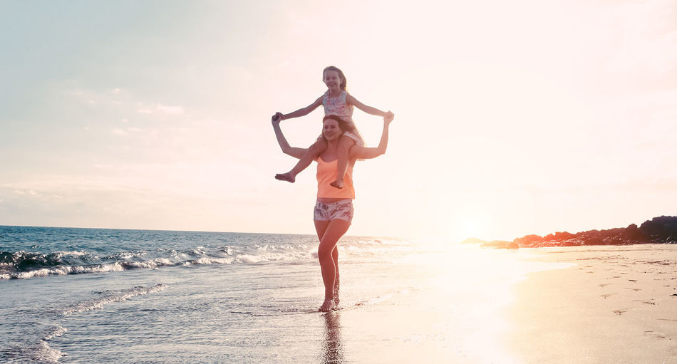 Mother having fun with daughter on the beach Freedom Fun Happy Holiday Love Mother SPAIN Weekend Balance Beach Daughter Enjoyment Lifestyles Nature Outdoors People Playing Sand Sea Sky Summer Sunlight Sunset Vacation Water