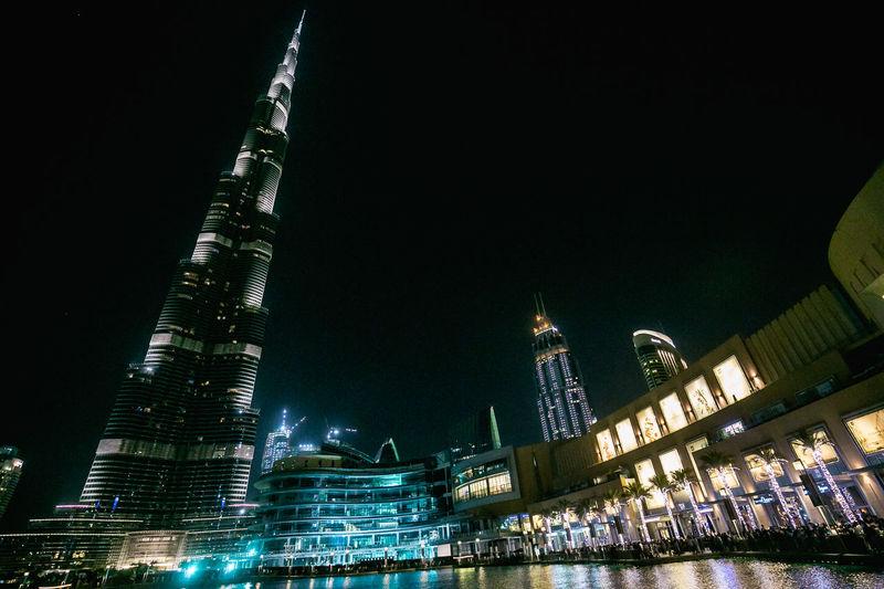Dubai emirates Building Canon Photography Photographer Nightshot Photography adventures in the city Dubai UAE Burj Khalifa Skyscraper Emirates Fountain Show City Cityscape Urban Skyline Illuminated Modern Skyscraper Nightlife Water Business Finance And Industry Sky