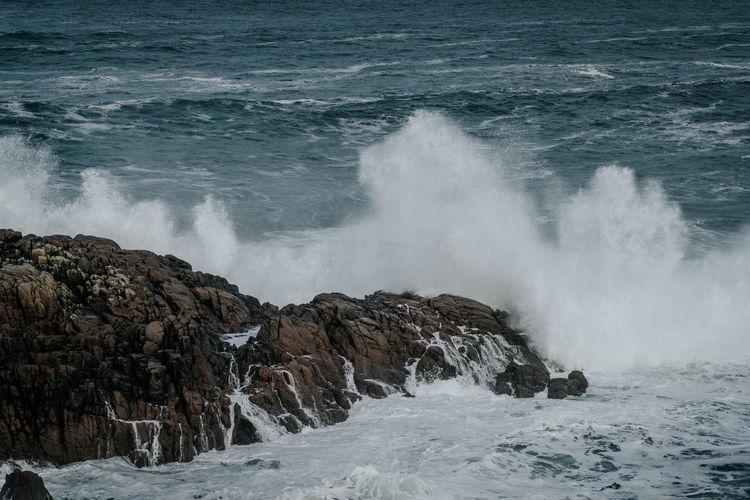 View of waves splashing on rocks