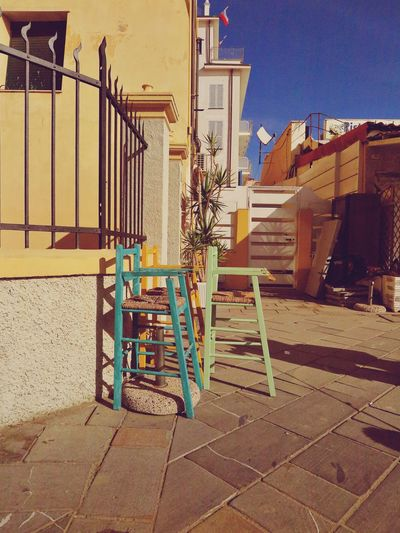 Sitting Sitting Outside Architecture Beach Building Exterior Built Structure Chairs Children's Chair Day For Children House Italy Jacket Lifeguard  No People Outdoors Pastel Restaurant Seat Street Photography Streetphotography