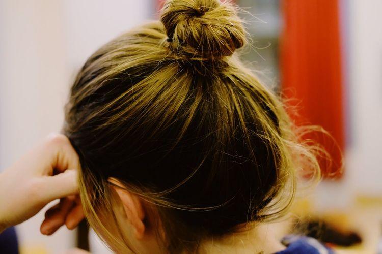 Close-up of woman with hair bun