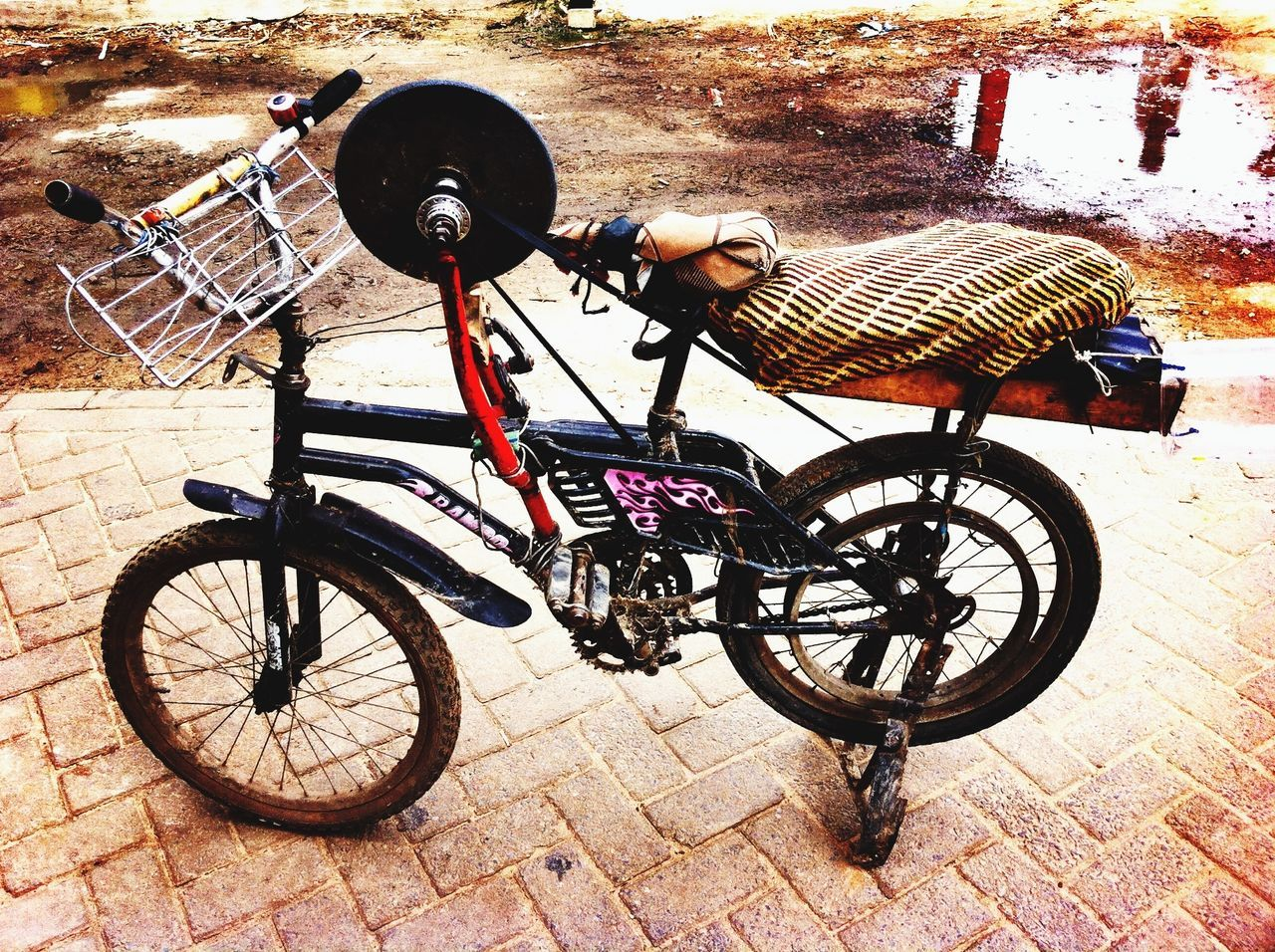 bicycle, land vehicle, stationary, transportation, mode of transport, wheel, outdoors, bicycle basket, day, no people, scooter, bicycle rack, childhood