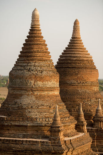 Close-up of stupas against clear sky