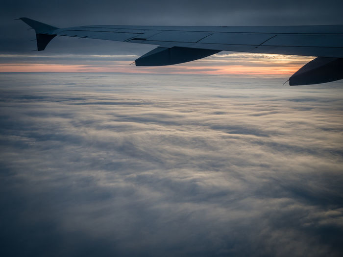 Aerial View Air Vehicle Aircraft Wing Airplane Airplane Wing Between Clouds Cloud - Sky Cloud Carpet Cloudscape Flying Flying High Journey No People Peaceful Sky Someplace Else Sunset Transportation Travel Up And Away