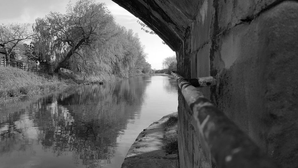 Under A Bridge Water Bridge - Man Made Structure No People Outdoors Day Nature Canal Blackandwhitephotography Close-up Hand Rail Serenity