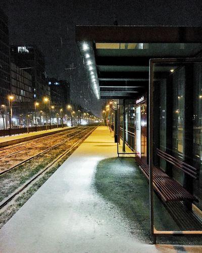 Illuminated railroad station at night during winter