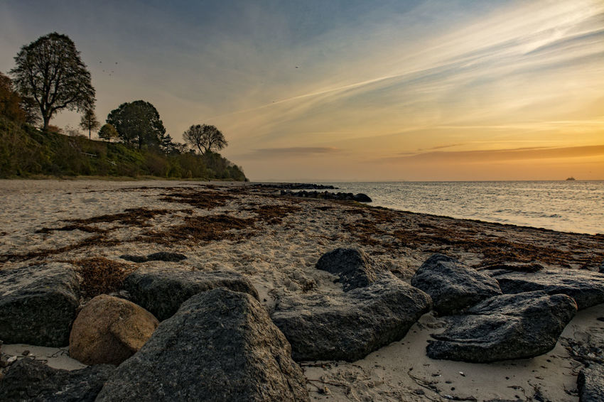 beach Orange Schleswig-Holstein Sky And Clouds Tranquility Trees Beach Horizon Over Water North Germany Rocks Sand Sunrise Water