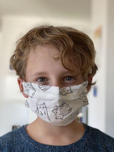 Portrait of boy wearing mask
