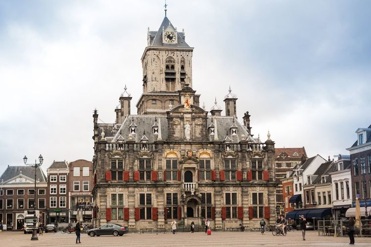 Building Exterior Architecture Built Structure Sky City Travel Destinations Religion Mode Of Transport Cloud - Sky Place Of Worship Transportation Cultures City Life Historical Building The Netherlands Delft Townhall Monument Old Town Day Spirituality Outdoors Real People Clock Tower