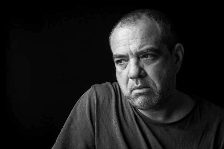 Sad adult male close-up. black and white portrait