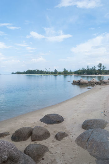 Let's vacation in Bintan island Beach Beauty In Nature Bintan  Bintan Island Bintanisland Blue Sky Day Daylight Let's Vacation In Bintan Island Nature Rock - Object Rock Formation Scenics Sky Tranquil Scene Tranquility Travel Travel Destinations Trikorabeach Vacation Vacations Water