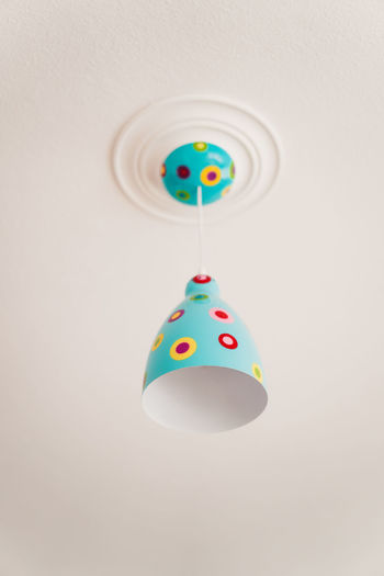 Craft Items Craftsmanship  Vintage Craft Arts And Crafts Indoors  Multi Colored Studio Shot No People Hanging Shape White Background Copy Space Design Close-up Still Life Decoration Ceiling Geometric Shape Wall - Building Feature Cut Out Creativity Circle Single Object Pendant Light