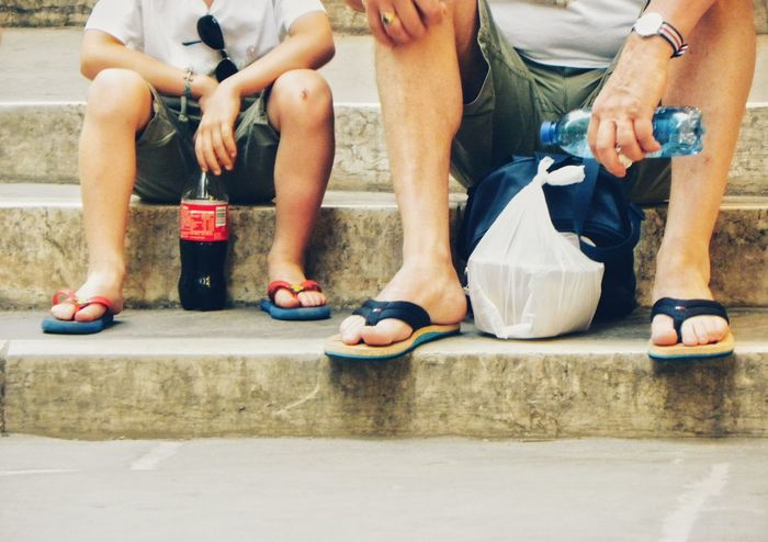 Low Section Sitting Day Men Two People Lifestyles Togetherness Leisure Activity Father And Son Summer Hot Weather Summer Clothing Flip Flops Talking Drinking Coca Cola Drinking Refreshment Real People Sitting On Steps Vacations Holidays Advice Talking With My Son Enjoying Time With My Little Man Coca Cola