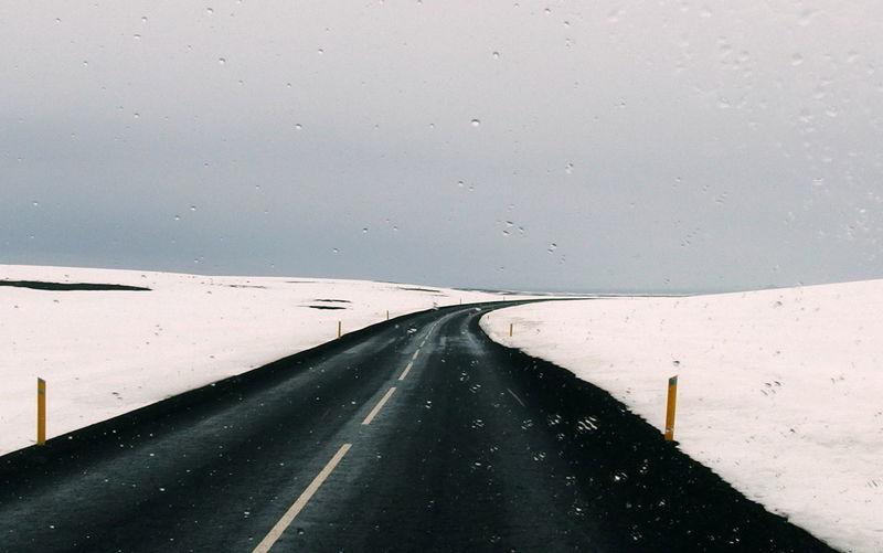 Road seen through wet windshield
