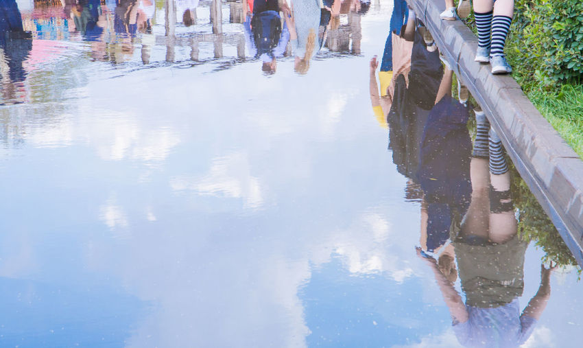 Reflection of people in water Body Part Childhood Day Group Of People Human Body Part Human Foot Human Leg Leisure Activity Lifestyles Low Section Men Nature Outdoors People Real People Reflection Standing Togetherness Water Women