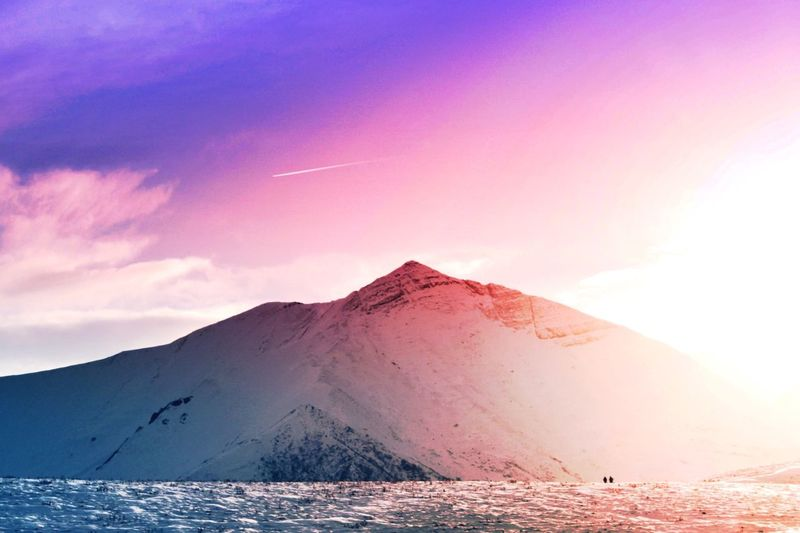 Mountain Scenics Beauty In Nature Tranquil Scene Nature Sky No People Landscape Non-urban Scene Cold Temperature Physical Geography Outdoors Mountain Range Sunset Cloud - Sky Snow Day Erupting