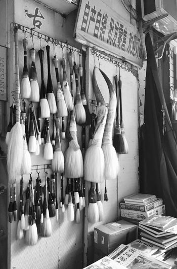 Paintbrushes Hanging in Art Store at Dafen Oil Painting Village in Shenzhen, China Paintbrush Paintbrushes Art Store Art Shop Black And White Dafen Oil Painting Village Dafen Dafen Art Store Shenzhen China Art Arts Painting Painting Supplies Street Photography On The Street Chinese Street Photography