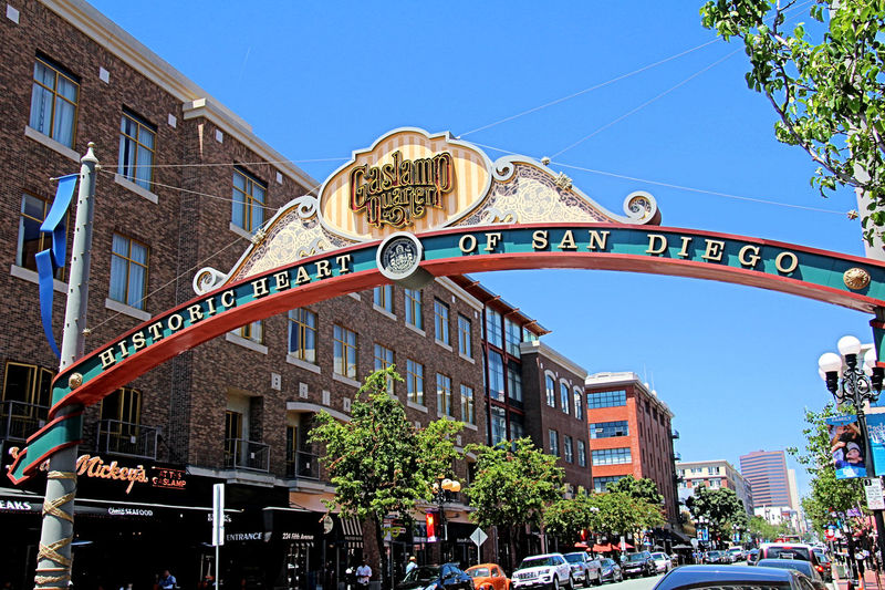 Just past Horton Plaza, we enter the Historic Gaslamp Quarter (the old Stingaree District). Brothels, drug dens, and gambling halls once dominated the landscape of downtown San Diego's Gaslamp Quarter, where visitors will now discover an array of fine restaurants, trendy nightclubs, and unique shops. The Gaslamp Quarter, the area of downtown directly across from the Convention Center and meeting hotels, is the heart of the city and a fine example of successful urban renewal. Until just a couple of decades ago, few residents or visitors would set foot in the area, but now thousands fill its streets nightly to dine, shop, and enjoy its historic character. Originally, the center of San Diego was located a few miles north of its present location in what is now called Old Town. In 1867, Alonzo Horton, the father of downtown San Diego, sailed into the bay and purchased several hundred acres of waterfront property and proceeded to build a wharf at the end of Fifth Avenue (roughly where the city's convention center now sits). Within a few years businesses and residences filled in the surrounding area and downtown San Diego began to thrive. San Diego, California, Gaslamp Quarter, Stingaree, Architecture, Buildings, Downtown, Historic, Bawdy, Dining, Nightclub, Architecture Building Exterior Built Structure Day Outdoors