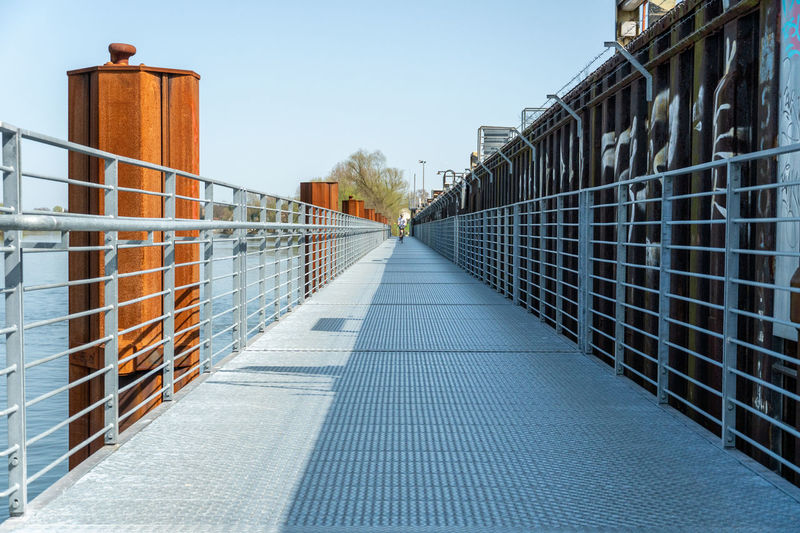 Architecture Building Building Exterior Built Structure City Clear Sky Day Diminishing Perspective Direction Footpath Metal Nature Outdoors Pattern Protection Railing Security Sky The Way Forward