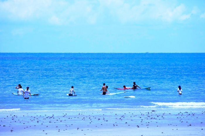 Fun Fun Fun No Waves Sea Water Horizon Over Water Sky Horizon Group Of People Scenics - Nature Beauty In Nature Real People Blue Lifestyles Beach Nature Day Sport Leisure Activity Outdoors