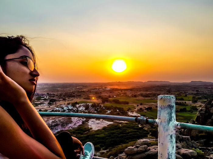 EyeEmNewHere Sunset One Person One Woman Only Vacations Outdoors Adult People Adults Only Only Women Cityscape Water Sky Day