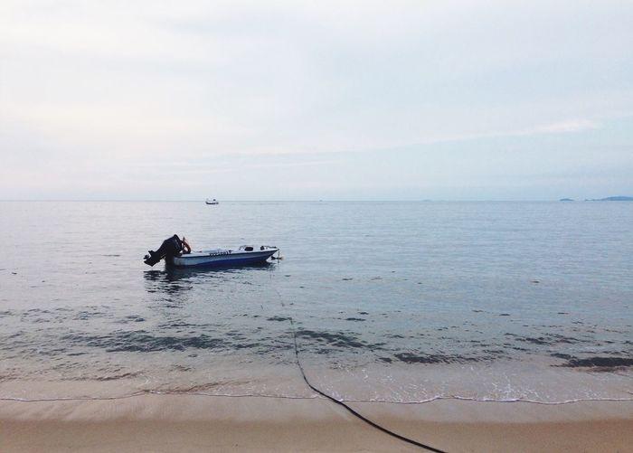 Motorboat Moored On Sea Against Sky