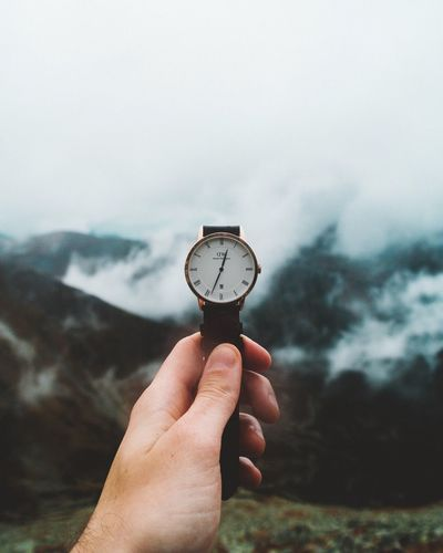 Lost In The Landscape Human Hand Human Body Part Time Holding One Person Human Finger Unrecognizable Person Clock Personal Perspective Sky Watch Wristwatch Outdoors Focus On Foreground Day Nature Mountain Real People Close-up Beauty In Nature Danielwellington Watch The Clock