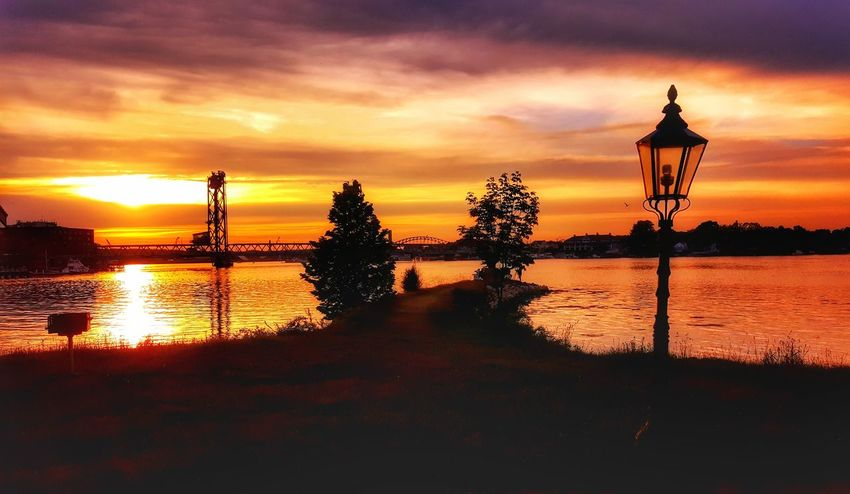 Sunset Reflection Sky Nature Outdoors Water No People Social Issues Tree Scenics Bridge - Man Made Structure Technology Day Good Morning! Tranquility EyeEm Best Shots - Landscape EyeEm Best Shots Dramatic Sky Sun Reflection Cloud - Sky