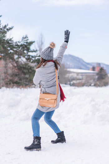 Asian  Japan Japan Photography Japanese  Sapporo,Hokkaido,Japan Snow ❄ Adult Arms Raised Casual Clothing Clothing Cold Temperature Day Full Length Human Arm Leisure Activity Lifestyles Nature One Person Outdoors Portrait Real People Rear View Sapporo Snow Snowing Walking Warm Clothing Winter Women