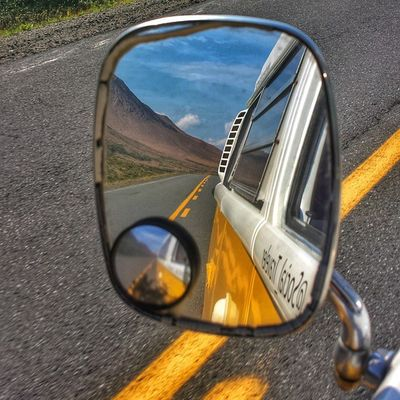 Rear view mirror view • [ TstPics ] Cruising through the Table Lands in Gros Morne. • Tstcanada with @explorecanada & @nfldandlabrador & @visitgrosmorne • Explorecanada TravelNL • Travel Canada Newfoundland Photography grosmornerocks Westfalia T2 Roadtrip •
