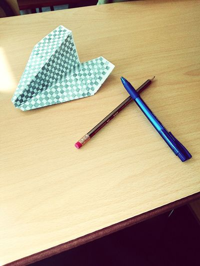 Indoors  Table High Angle View Paper Wood - Material No People Close-up Day School Pen Pencil Paperplane