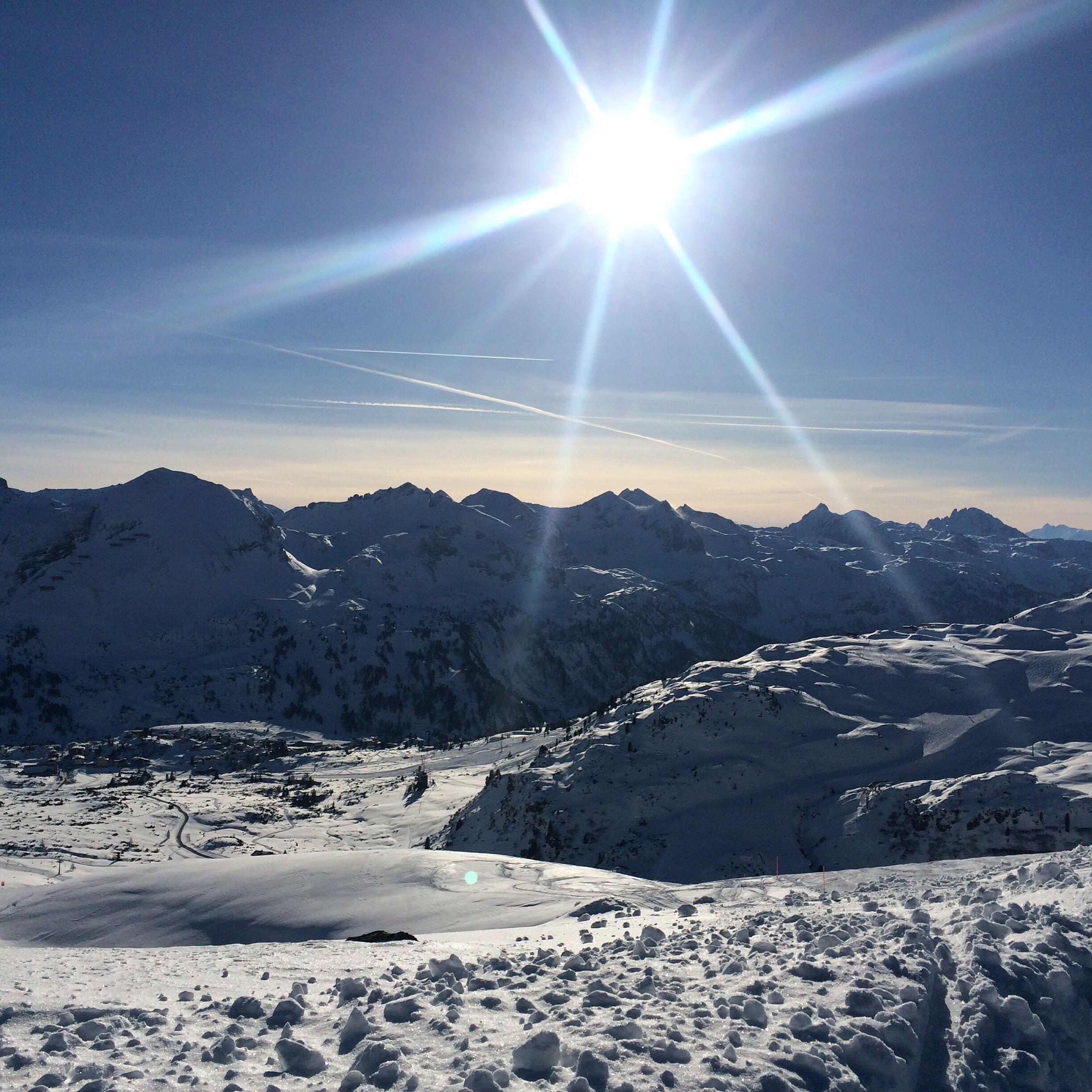 snow, sun, winter, cold temperature, mountain, sunbeam, tranquil scene, sunlight, tranquility, mountain range, scenics, landscape, beauty in nature, lens flare, nature, season, snowcapped mountain, sky, weather, sunny