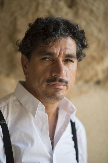 Portrait of man in formalwear against wall