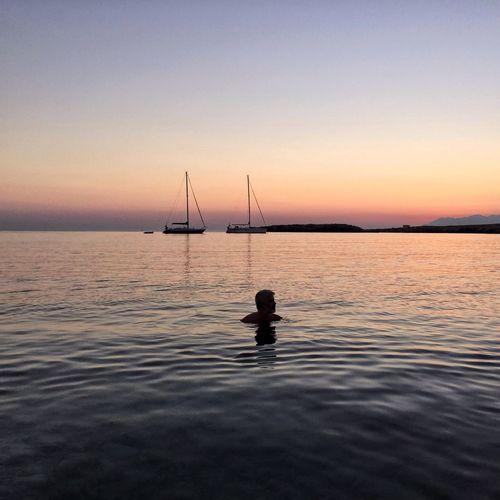Silhouette of fishing boat in sea