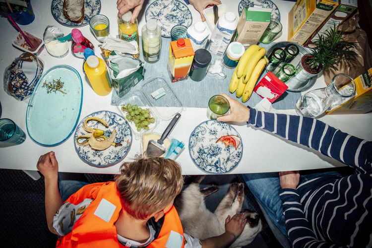 High angle view of people sitting on table