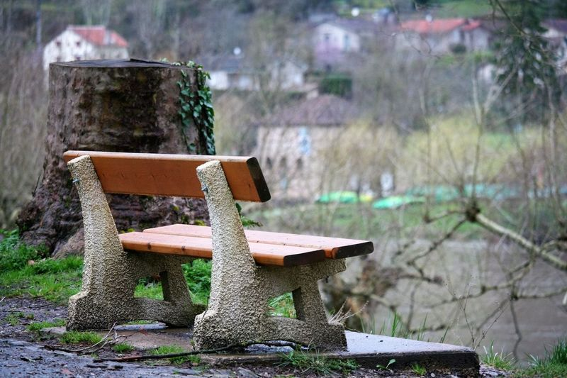 Empty Bench By River In Village