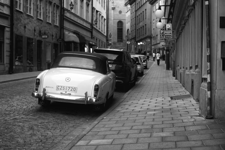 Cars on street amidst buildings in city