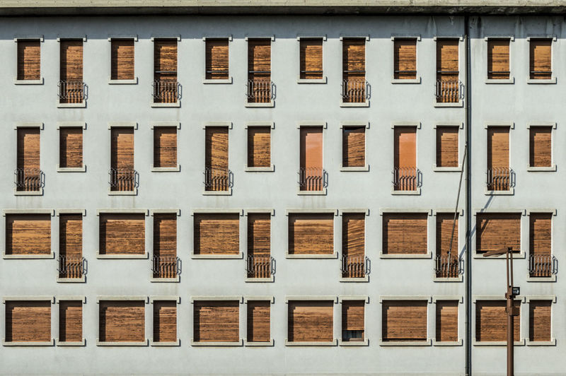 Concrete facade with series of facade of windows and small balconies Architecture Backgrounds Brown Building Building Exterior Built Structure City Day Full Frame Glass - Material House In A Row No People Outdoors Pattern Repetition Residential District Row House Side By Side Window Wood - Material