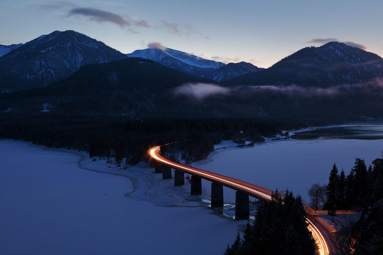 Mountain Road Karwendel Hiking Lights Twilight Alpine Landscape Alps Beauty In Nature Bridge Cold Temperature Dusk Evening Lake View Mountain Mountain Range Nature Night No People Non-urban Scene Outdoors Scenics - Nature Snow Snowcapped Mountain Tranquility Winter