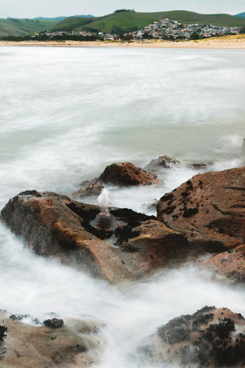 Aquatic Sport Beach Beauty In Nature Blurred Motion Breaking Day Flowing Flowing Water Land Long Exposure Motion Nature No People Ocean Outdoors Power In Nature Rock Rock - Object Scenics - Nature Sea Solid Sport Water Wave Waves EyeEmNewHere