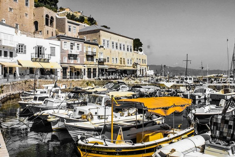 EyeEm Selects Nautical Vessel Building Exterior Architecture Mode Of Transport Harbor Moored Transportation Water Outdoors Built Structure Sea No People Travel Destinations Yacht Day City Cityscape Sky Paint The Town Yellow