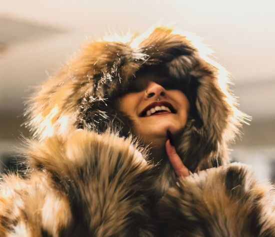 Fur Warm Clothing Real People Fur Coat Smiling Young Women Winter Lifestyles Young Adult Leisure Activity Happiness One Person Beautiful Woman Headshot Portrait Close-up Outdoors Nature Cold Temperature Snow