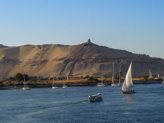 Ancient Egyptian Boat Trip On The Nile By The River Deserts Around The World Dream Dreaming Egypt Egyptology Exploring Mountain Range Nautical Vessel Rêve Sea Ship Sur Le Nil The Nile The Nile River Tranquility Travel Travel Photography Trip Vacation Vacations Voilier Voiliers Miles Away