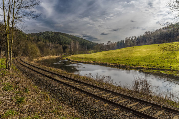 clouds versus sun Atmosphere Dark Beauty In Nature Cloud - Sky Clouds And Sky Day Grass Green Color Nature No People Outdoors Rail Transportation Railroad Track River Scenics Sky Sun Trail Transportation Tree Water Waterfront