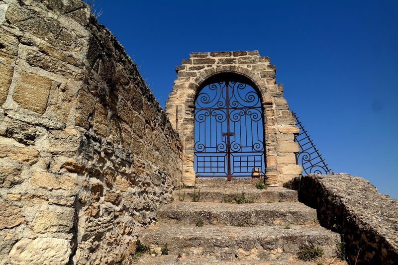 Ancient Arch Blue Sky Built Structure Chateauneufdupape Clear Sky Entrance Entryway EyeEm Best Shots EyeEm Gallery Famous Place Fence France From My Point Of View History Portal Provence Stairway Stairway To Heaven Steps Stone - Object Stone Material Stone Wall The Week On EyeEm Wall - Building Feature