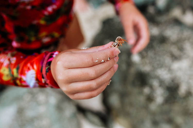 Close-up of woman hand holding rock