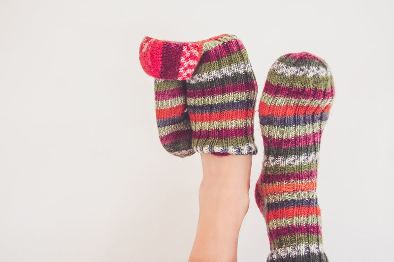 Autumn Autumn Colors Cold Weather Colours Foot Winter Winter Clothes Clothes Colourful Clothes Copy Space Cosy Feet Lifestyles People Putting On Sock Socks Wearing Socks White Background Wool