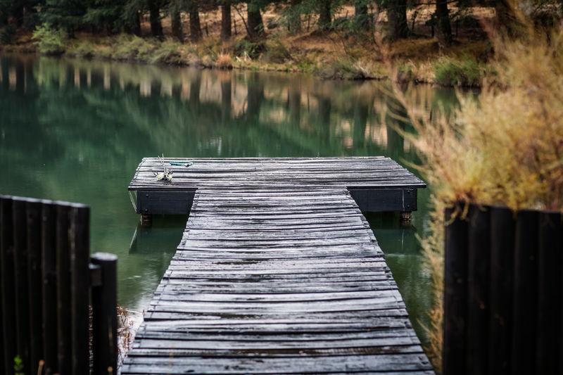 Wooden jetty in fishing lake